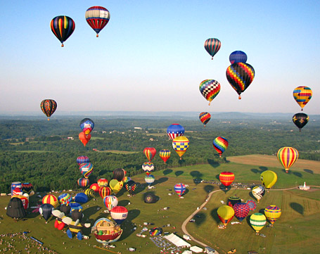 Over 100 hot air balloons and special shapes lift off during the