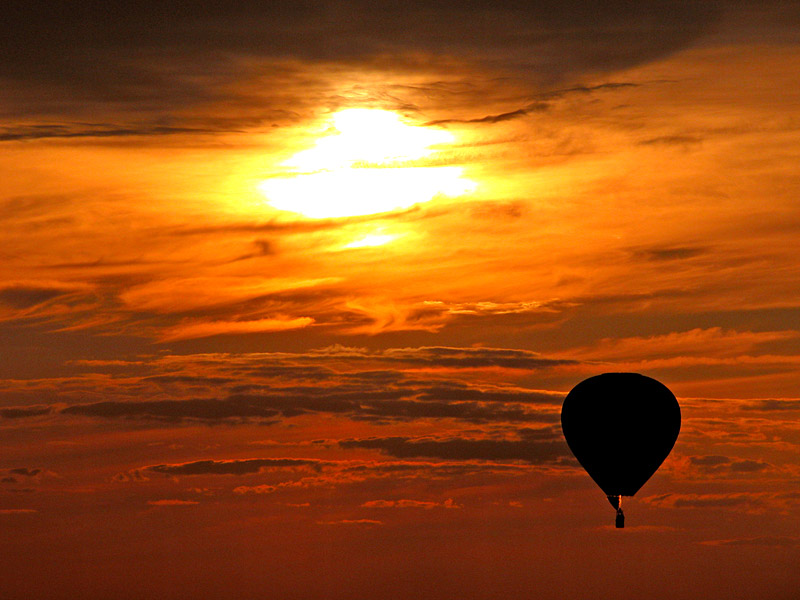 Spectacular sunset hot air balloon flight over the mountains of